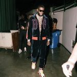 Rapper Gucci Mane Performs In A Dolce & Gabbana Embroidered Logo Sports Jacket & Velvet Track Pants