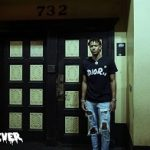 College Basketball Player Rodney Carson Jr. Wears A Christian Dior Men's X Kaws T-Shirt