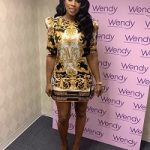 Remy Ma Styles In A Versace Short-Sleeve Silk Dress & Palazzo Platform Pumps