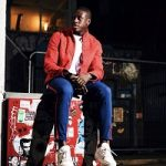 French Footballer Benjamin Mendy Dressed In A Louis Vuitton Monogram Soft Denim Jacket And LV Trainer Sneakers
