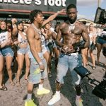 Lil Baby Wears Amiri Crochet-Panelled Distressed Printed Denim Shorts & Alexander McQueen Leather Sneakers At Video Shoot