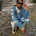 """Offset Does An Impromptu Photoshoot In A Kapital Embroidered Denim Jacket, Burberry Bleached Splatter Effect Jeans And Air Jordan 14 """"Yellow Ferrari"""" Sneakers"""