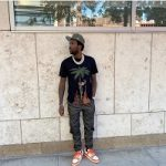 Meek Mill Spotted In A Palm Angels Black Burning Skeletons T-Shirt And Louis Vuitton LV Trainer Sneakers