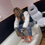 Rapper Lil Durk Wears An Off-White Green And Orange Varsity Bomber Jacket & Nike Dunk Low SP Syracuse Sneakers