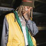 Lil Durk Wears A Prada Color-Block Nylon Jacket & Technical Bucket Hat