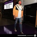 Anthony Davis Dressed In A Gucci Floral Print Shell Hooded Jacket & Off-White Futura Atoms T-Shirt