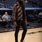 Basketball Player Jaren Jackson Jr. Styles In A Fendi Reversible Padded Down Jacket & Travis Scott Air Jordan 1 High