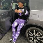 Mikey Williams Wears A Never Broke Again Retro Baby Black Purple Hoodie, Valabasas Stacked Aerglo Purple Jeans And Nike Dunk Low Retro White Black Sneakers
