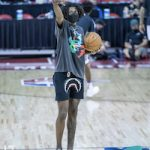Jalen Green Styles In A BATHING APE® Shark-Print Track Shorts & adidas Red Blackburn Suede Sneakers